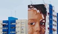 L'ARTE E LA DENUNCIA/ E' di Giorgio Di Ponzio il volto del bambino disegnato da Jorit a Taranto